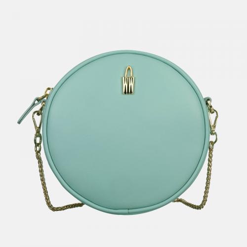 Okrągła mała torebka ze skóry naturalnej w kolorze miętowym Bella